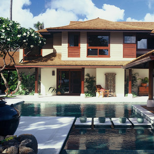 Inspiration for a tropical wood exterior home remodel in Hawaii