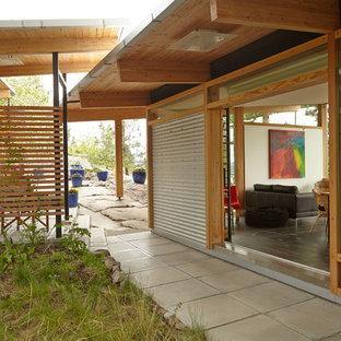 Idéer för industriella hus, med allt i ett plan och metallfasad