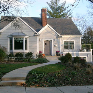Example of a mid-sized classic gray one-story concrete fiberboard gable roof design in Detroit