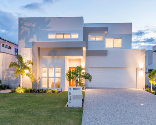 This Is An Example Of A Contemporary Two Storey Stucco White Exterior In Gold Coast