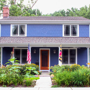 Example of a small classic purple two-story wood exterior home design in DC Metro