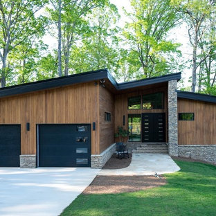 Inspiration for a mid-sized modern brown two-story wood exterior home remodel in Atlanta with a shed roof