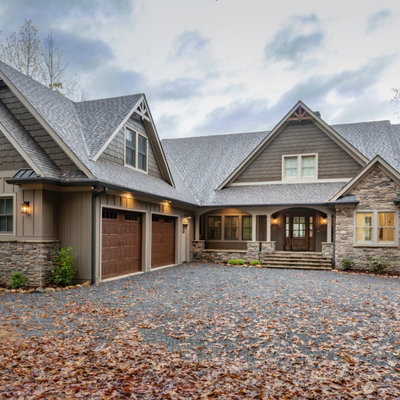 Large mountain style brown two-story concrete fiberboard exterior home photo in Atlanta with a mixed material roof