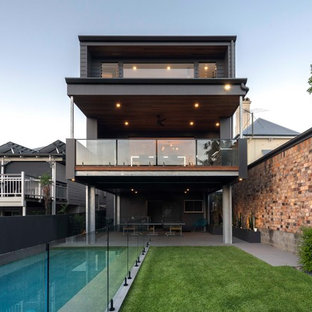 Contemporary grey exterior in Brisbane with three or more storeys and a gable roof.