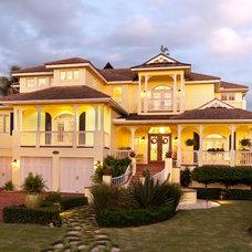 Tropical Exterior by Kukk Architecture & Design P.A.