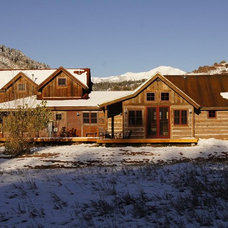 Rustic Exterior by Alpenglow Building & Design Inc.
