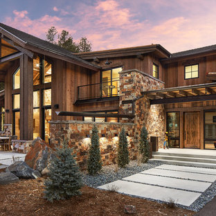 Large rustic two-story wood exterior home idea in Denver