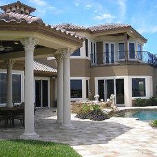 Mediterranean Exterior by Arieno Custom Home Design