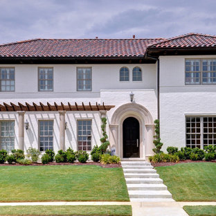 Example of a large tuscan exterior home design in Dallas