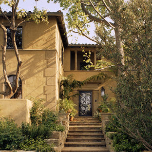Design ideas for a mediterranean two-storey exterior in Los Angeles.