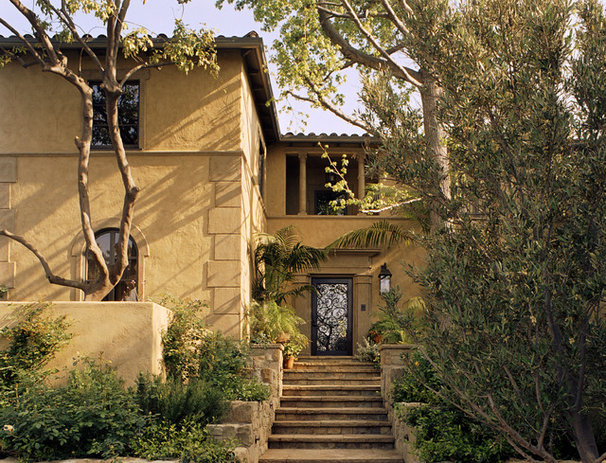 Mediterranean Exterior by Tommy Chambers Interiors, Inc.