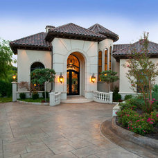 Mediterranean Exterior by AVID Associates LLC