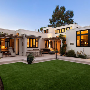 Mid-sized tuscan white two-story stucco flat roof photo in Santa Barbara