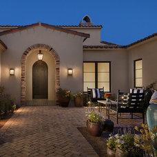 Mediterranean Exterior by Calvis Wyant Luxury Homes
