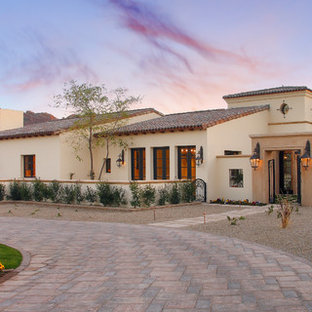 Large tuscan two-story stucco exterior home photo in Phoenix