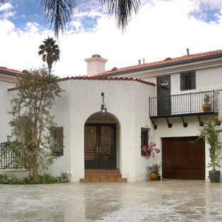 Example of a large tuscan white two-story stucco exterior home design in Los Angeles