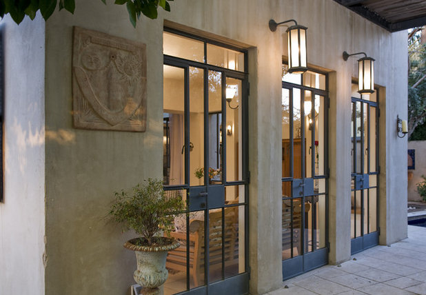 Nail your curb appeal mediterranean style for Mediterranean style front doors