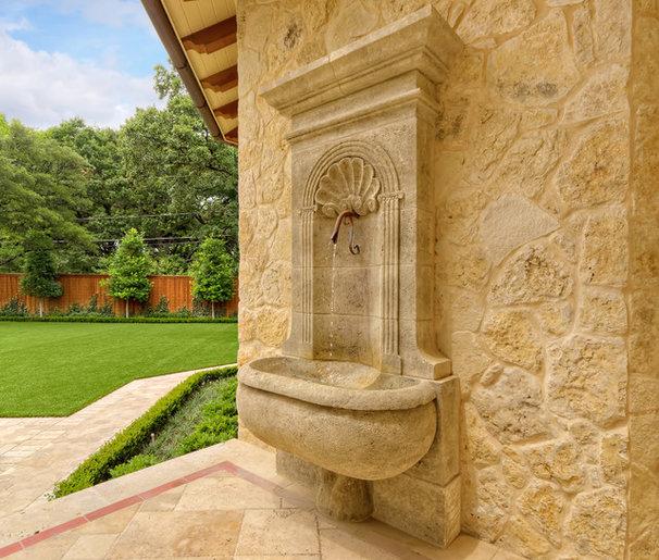 Mediterranean Exterior by Harold Leidner Landscape Architects