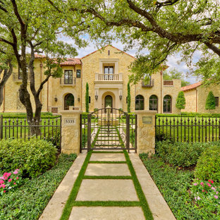 This is an example of a mediterranean house exterior in Dallas with stone cladding.