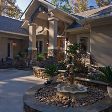 Mediterranean Exterior by Pippin Home Designs, Inc