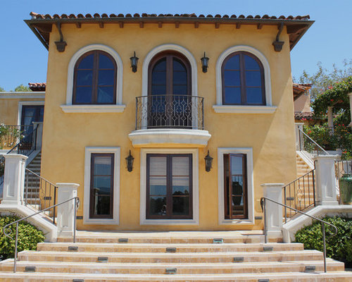 Stucco Design Ideas natural simple design house color ideas with white garage door can add the modern touch inside it also has small windows with brown roof design ideas 5375 Stucco Exterior Home Design Photos With A Hip Roof