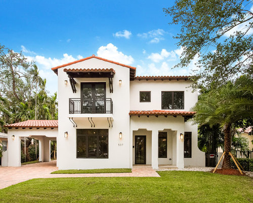 Example Of A Tuscan White Two Story Stucco Exterior Home Design In Miami  With A