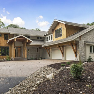 Inspiration for a mid-sized contemporary gray two-story mixed siding exterior home remodel in Minneapolis with a shingle roof