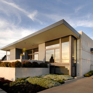 Example of a minimalist one-story exterior home design in Seattle
