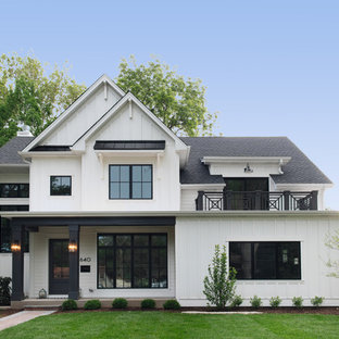 Inspiration for a country white two-story wood exterior home remodel in Chicago with a shingle roof