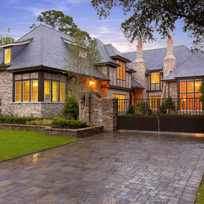 Inspiration for a mediterranean two-story brick exterior home remodel in Houston with a hip roof