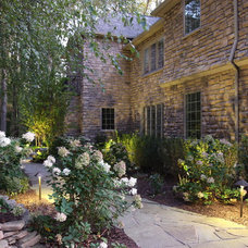 Traditional Exterior by SPLASH pool design by Brian T. Stratton