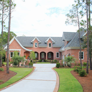 Example of a classic two-story brick exterior home design in Wilmington