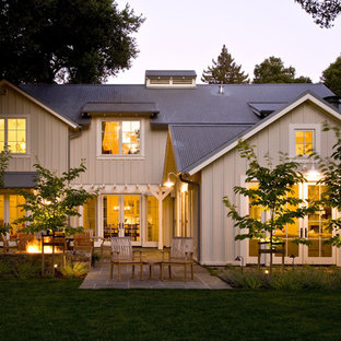 Example of a country wood exterior home design in San Francisco