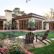 Mediterranean Exterior by Allwood Construction Inc
