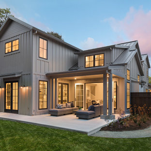 Example of a large country gray two-story wood exterior home design in San Francisco with a metal roof