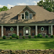 Traditional Exterior by BROWN DAVIS INTERIORS, INC.