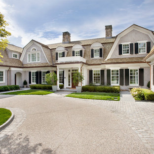 Traditional two-story wood exterior home idea in Boston with a gambrel roof