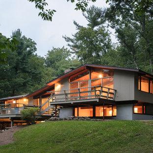 Midcentury modern gray split-level wood gable roof idea in Bridgeport