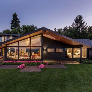 Inspiration for a mid-sized midcentury modern black one-story exterior home remodel in Sacramento with a shingle roof