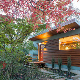 Inspiration for a mid-century modern brown one-story wood house exterior remodel in DC Metro with a shed roof