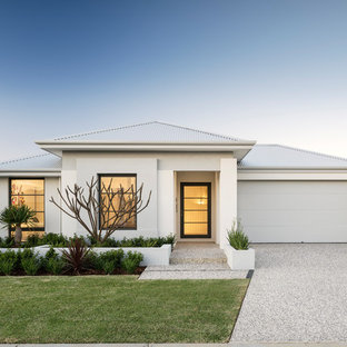 This is an example of a contemporary one-storey stucco white house exterior in Perth with a hip roof and a metal roof.
