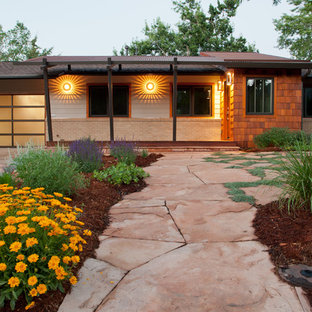 This is an example of a medium sized and beige classic one floor detached house in Denver with mixed cladding and a mixed material roof.