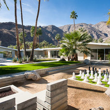 Midcentury Exterior by Iconic Palm Springs Vacation Rentals