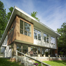 Modern Exterior by Coupard Architects and Builders