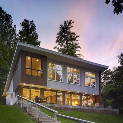 Trendy two-story exterior home photo in DC Metro with a shed roof