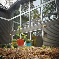 Midcentury Exterior by New Urban Home Builders