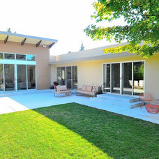 Midcentury Exterior by Rich Mathers Construction, Inc.