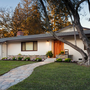 Photo of a medium sized and beige midcentury one floor render exterior in San Francisco with a flat roof.