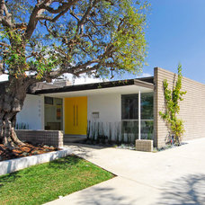 Midcentury Exterior by Brion Jeannette Architecture
