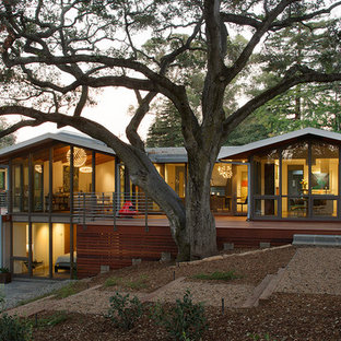 Inspiration for a large midcentury two-storey grey exterior in San Francisco with mixed siding and a gable roof.